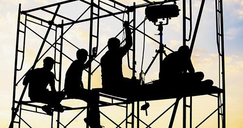 men sitting on scaffold